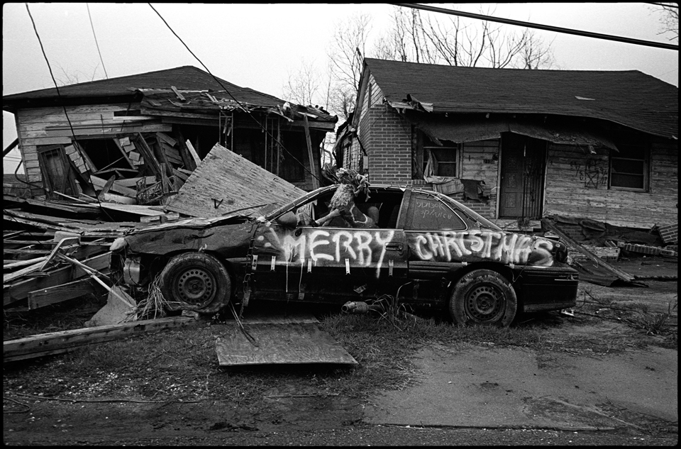 lower 9th ward after hurricane katrina - car with Merry Christmas graffitied on it