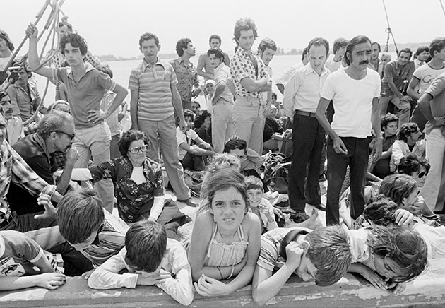 Cuban refugees wait aboard a boat at the port of Mariel, Cuba, bound for Key West, Fla., Saturday, April 23, 1980.  Cuban President Fidel Castro has agreed to let the Cubans leave the Communist island to start a new life in the United States.