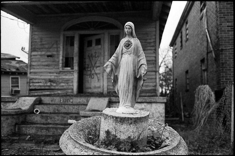 lower 9th ward after hurricane katrina - virgin mary water fountain in front of house