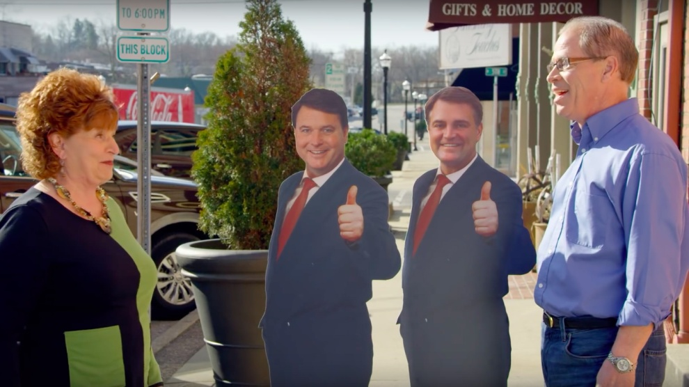 Mike Braun and cardboard cutouts