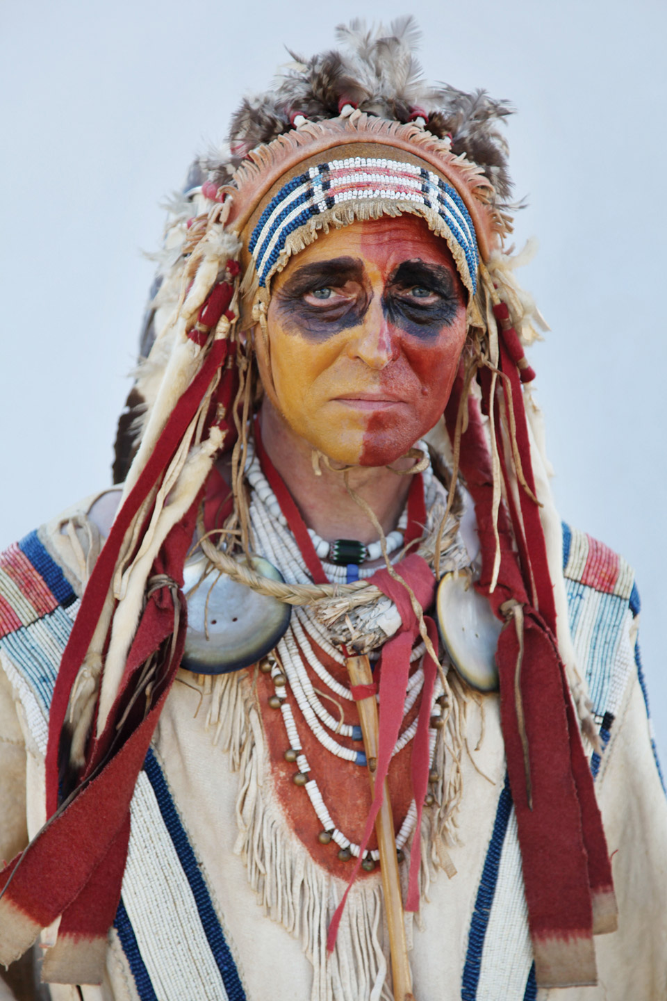 Portrait of man dressed as Native American.