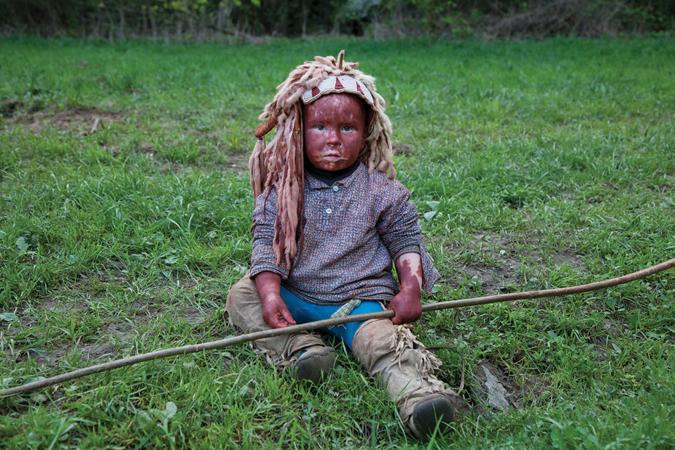 Baby dressed as Native American.