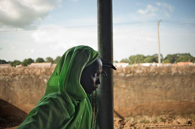 A woman waiting for consultation at Aweil Hospital, Northern Bahr-El-Ghazal State. South Sudan has one of the highest maternal mortality rates in the world, with one in seven women likely to die due to pregnancy related causes.