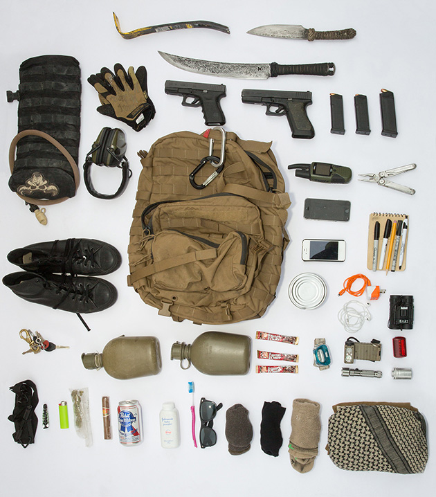 MM's bag contains several weapons and tools, three pairs of socks, waterproof paper and pens, an extra phone, marijuana, a beer, and a cigar.