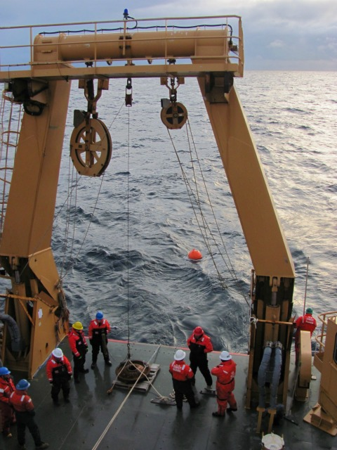 Deploying a mooring buoy from UCGC icebreaker Healy, Arctic Ocean, October 2012: Julia Whitty